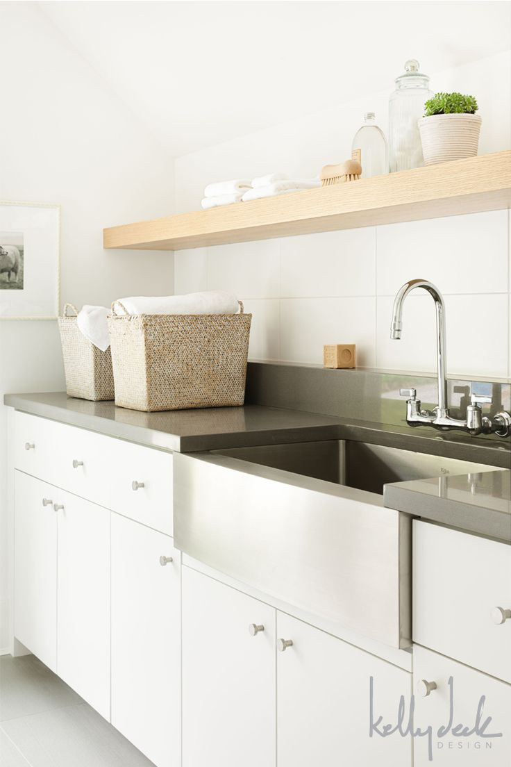 Stainless sink, Dark Countertops, White Cabinets, Wood Accents