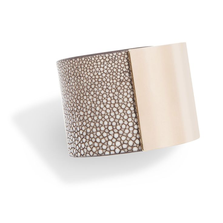 Momentum, a cuff bracelet in shagreen and rose gold-plated brass, hand crafted in a sleek and sophisticated design is the signature piece of De Galluchat.  #treasurethemoment #momentum #cuff #shagreen #degalluchat #galuchat #gold