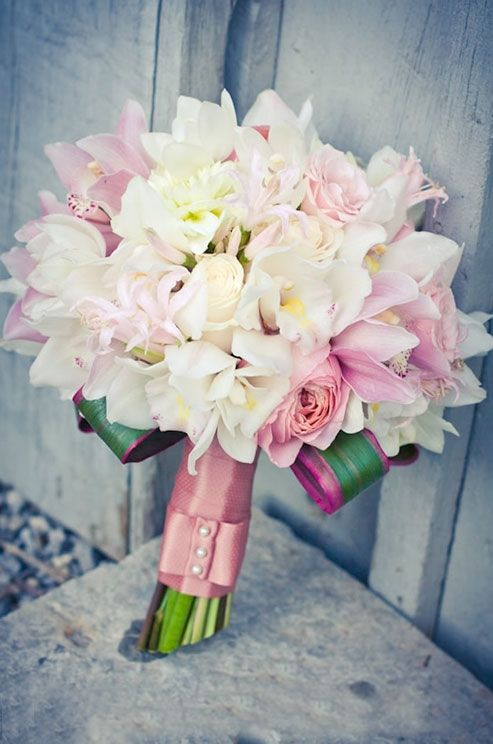 Such a romantic looking bouquet of white and pink  orchids and roses.