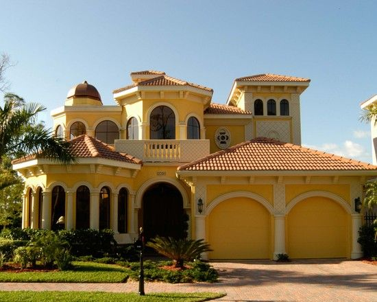 gorgeous luxury home exterior for custom home fancy mediterranean house design yellow garage door portofino