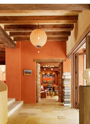 The orange and the warmth of the light and wood create a warm color scheme