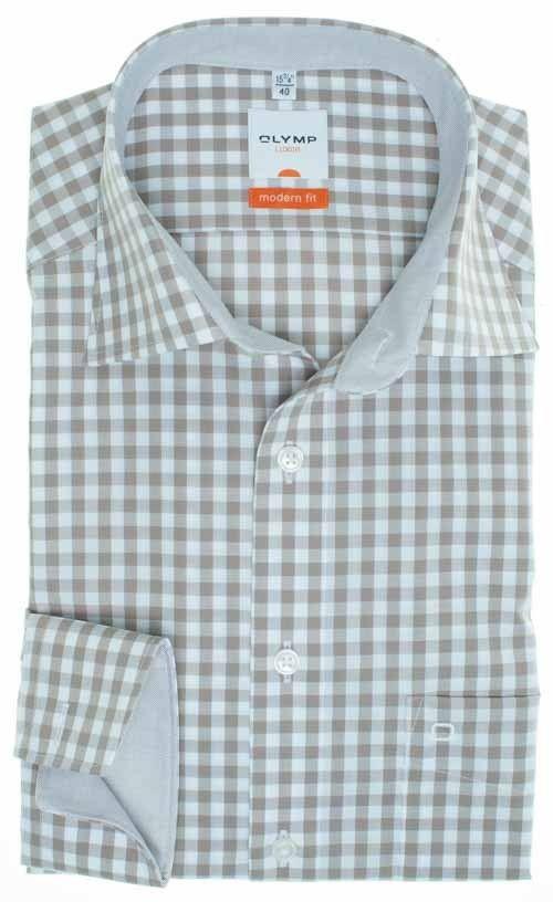 OLYMP Luxor modern fit Olymp overhemden zijn strijkvrij en kreuk vrij. De exclusieve zakelijke overhemden uit de nieuwste collectie zijn gemaakt van hoogwaardige stoffen. De trendy kleuren en ongewone ontwerpen en geraffineerde subtiliteit van de behandeling benadrukken het opvallende uiterlijk. Een Olymp Luxor overhemd past op elk kostuum maar staat net zo goed op een spijkerbroek.   Een Olymp Luxor draagt u de hele dag kreukvrij. De hemden hoeft u dan ook niet te strijken voor het dragen.