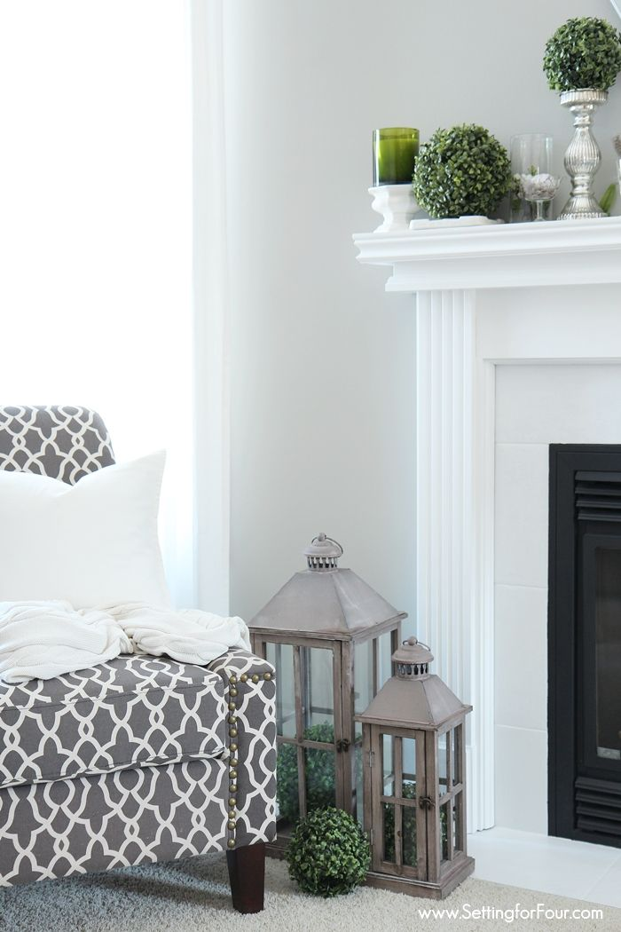 How to paint a tile fireplace surround - it's so easy to give your fireplace a stylish makeover! See how I turned blah beige tile to this chic white look!