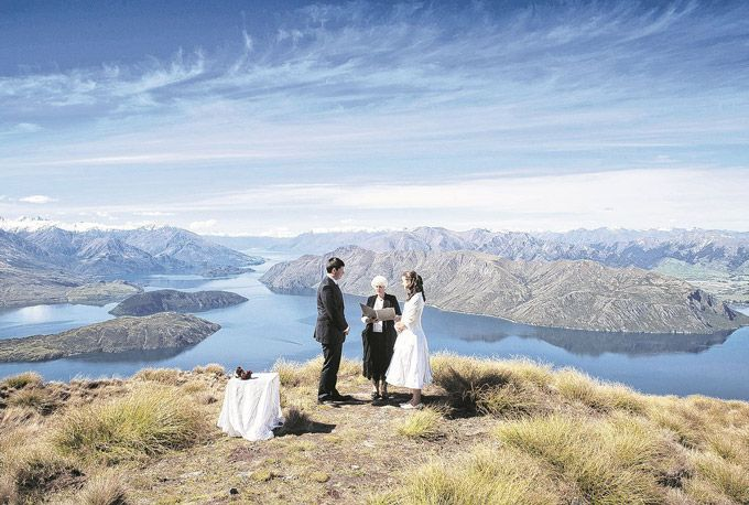 Want a wedding as cool as this picture? Click on it to find a cheap flight to New Zealand.