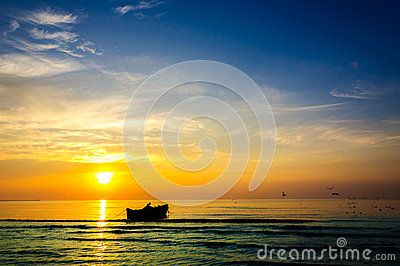 Fishing boat fishermen sunrise beautiful landscape rich colors. People working fishing coastline.