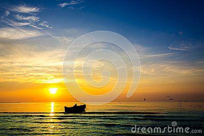 Fishing boat fishermen sunrise beautiful landscape rich colors. People working fishing coastline.