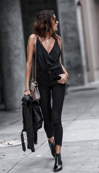 all black. wrap cami top. skinny jeans. ankle boots. leather jacket. street style.