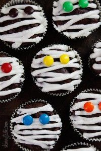 """Cupcake Mummies: Bake chocolate cupcakes as directed. Use white frosting to create the mummy look. Use M&M's as the eyes. halloween desert  Cemetery Cup-a-Dirt: Make chocolate pudding as directed. Crumble oreos to make the """"dirt"""". Alternate pudding and oreo crumbles in a small, clear cup. Use a Milano cookie for the headstone. Use frosting or melted chocolate to create """"RIP""""."""