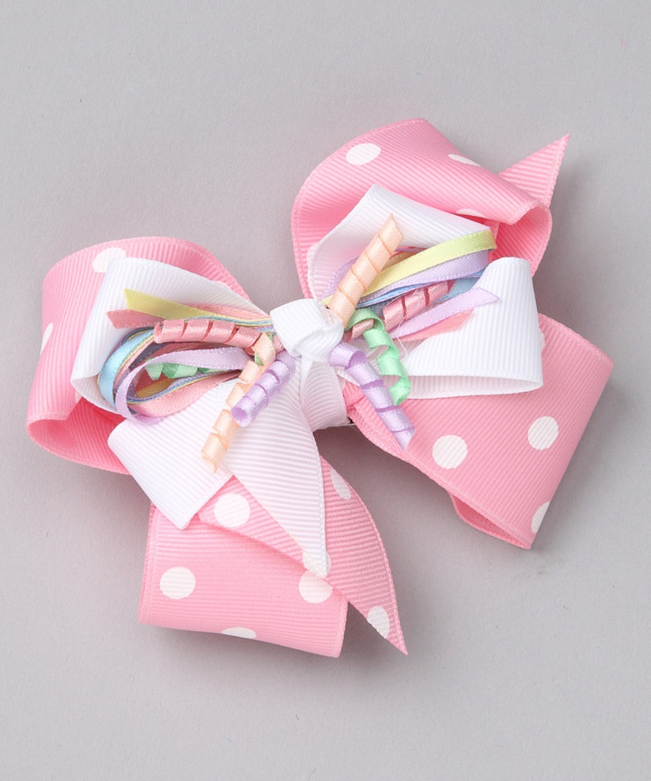 double ribbon bows with curly ribbon third layer on top