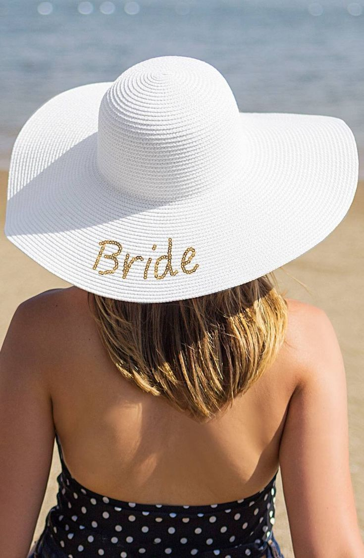 a9d973dab0394d A woven straw hat perfect for taking along on sunny honeymoons is detailed  with