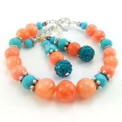 Zestaw biżuterii z kamieni naturalnych pomarańczowego marmuru i turkusowych kryształków.