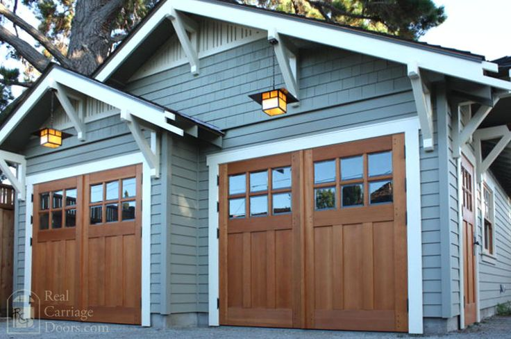 Make the left bay deeper and put the man door on the short perpendicular wall between the bays.