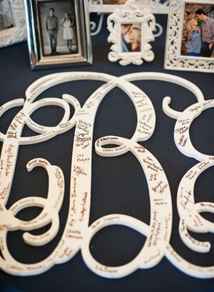 Monogram as a guest book.  I love guest books that don't just sit and collect dust and can be displayed as art.