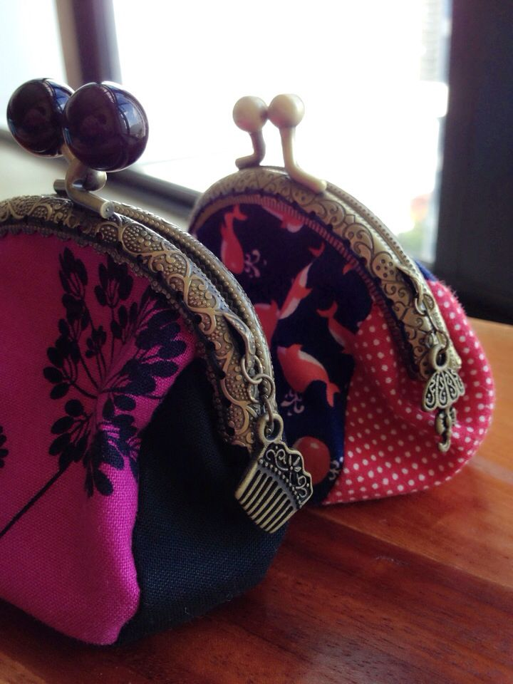 Metal frame coin purse with cute charms.