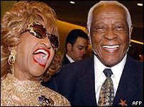 Celia Cruz and her husband Pedro Knight.    Cruz met Knight  while he was the bands trumpet player and were both part of the band Sonora Matancera.  They married on July 14, 1962.