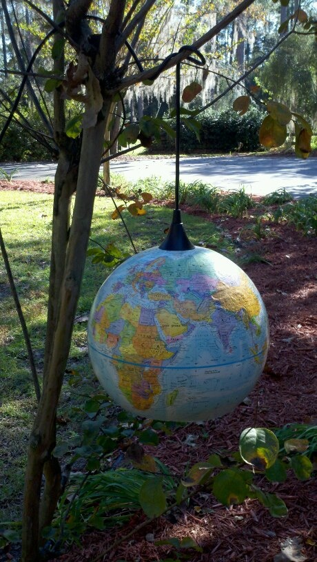 Anyone have an old globe?  These make awesome pendant lights for a classroom, desk area, or a homeschool room!
