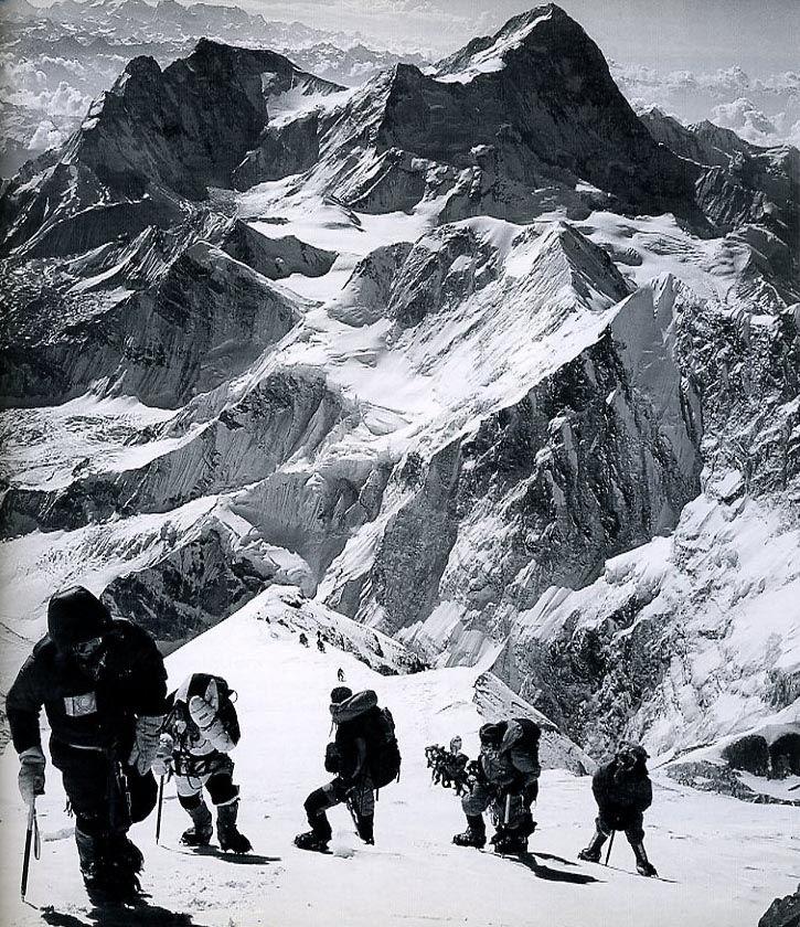 Anatoli Boukreev, Mike Groom, Jon Krakauer, Andy Harris, Lene Gammelgaard and a line of climbers on the Everest upper Southeast Ridge, with Makalu behind, on May 10, 1996 -