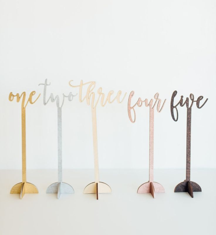 A one, a two, a one, two, three, four! Loving our table numbers! See more here: http://www.everlaser.com/shop/freestanding-script-table-numbers