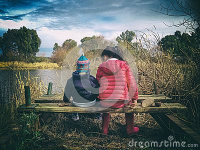 Children Throwing Stones To The River - Download From Over 54 Million High Quality Stock Photos, Images, Vectors. Sign up for FREE today. Image: 86015697