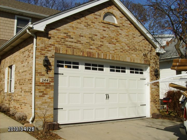 Haas Model RMT 660 Carriage House w/ 6 Pane Square Lite Top Section and Decorative & 12 best We sell Garage doors made by Haas. images on Pinterest ... pezcame.com
