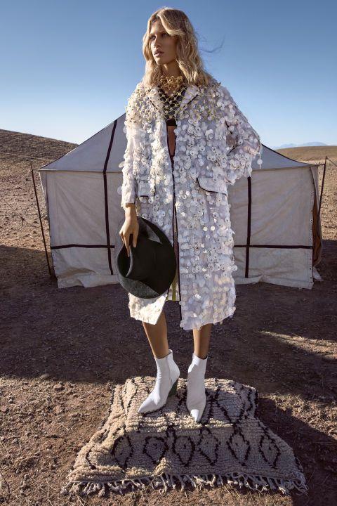 Prada coat, $12,820, sweater-vest, $1,190, skirt, $5,280, and neckpiece, $525, prada.com; Satya Twena hat (worn throughout), $425, satyatweena.com; Céline boots (worn throughout), $1,750, 212-420-7300.
