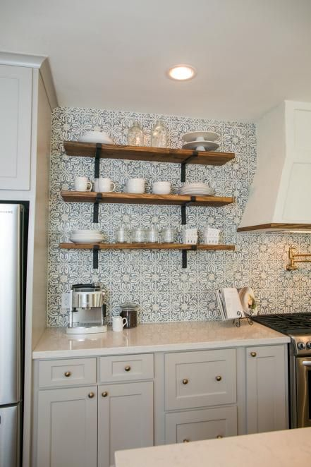 A close up of the open shelving and countertop in the kitchen of the newly renovated Childers home, as seen on Fixer Upper. (after)
