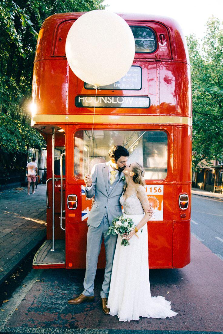 Bride & Groom Giant Balloon & Double Decker Bus - Image by Michael Newingon Gray | Jacqueline Byrne Wedding Dress | Ceremony & Wedding Breakfast at Asylum Peckham, London | The Blacksmith & The Toffeemaker