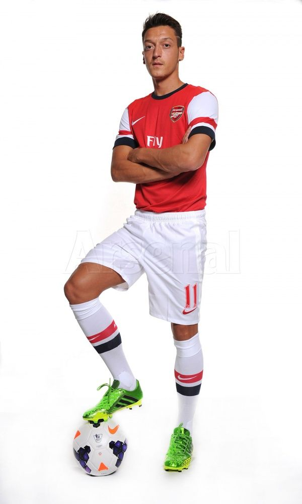 Star signing Mesut Ozil photoshoot in his new Arsenal kit