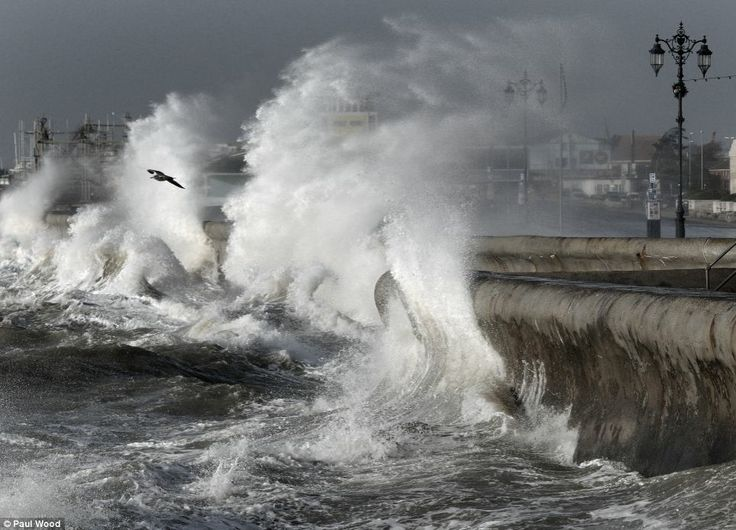 Gales of up to 80mph and 35 feet waves have created further flooding misery as a fresh series of storms sweep across Britain. Pictured: Giant waves lash the seafront in Southsea, Hampshire