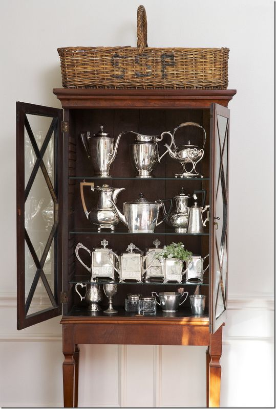 """""""RENOVATION STYLE:   This cabinet in the dining room once had no legs – the homeowner had her carpenter add them!!  Inside is a collection of antique and hotel silver."""""""