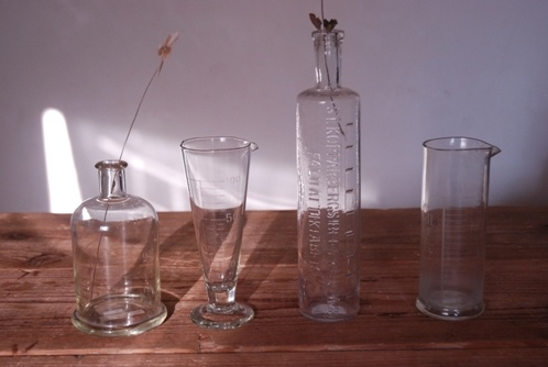 Old glas bottles and measures from Japan and Sweden.