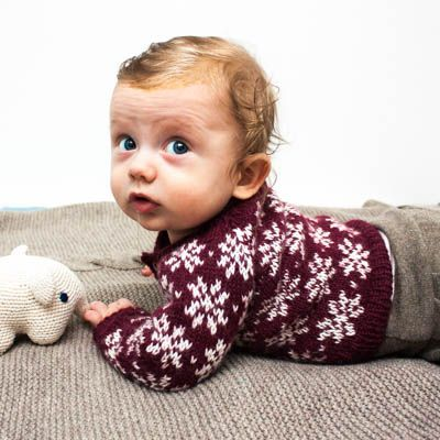 A baby and toddler knitting pattern to make a colour work cardigan, the…