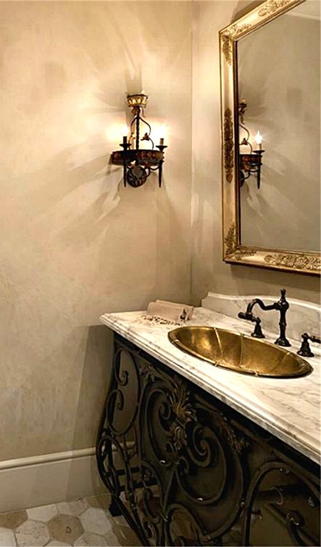 the iron vanity in this powder room