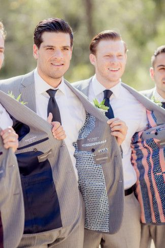 Groom with groomsmen showing off their different silk liners