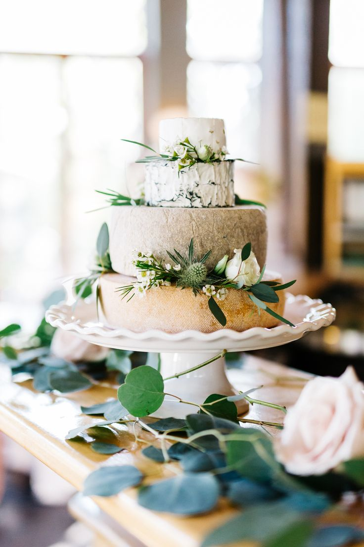 Wedding Cheesecake - A wedding cake made of cheese wheels.  Cheese wheel wedding cake.