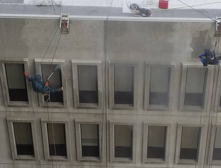 Take a look at these people pressure washing a building in Seattle by rope access from the roof.