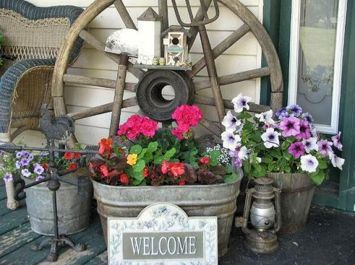 Porch Display With Old Wagon Wheel