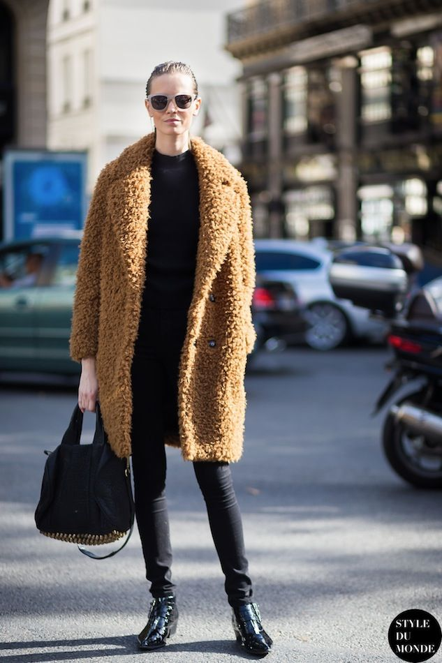 Mina Cvetkovic in a textured camel coat, black jeans & boots