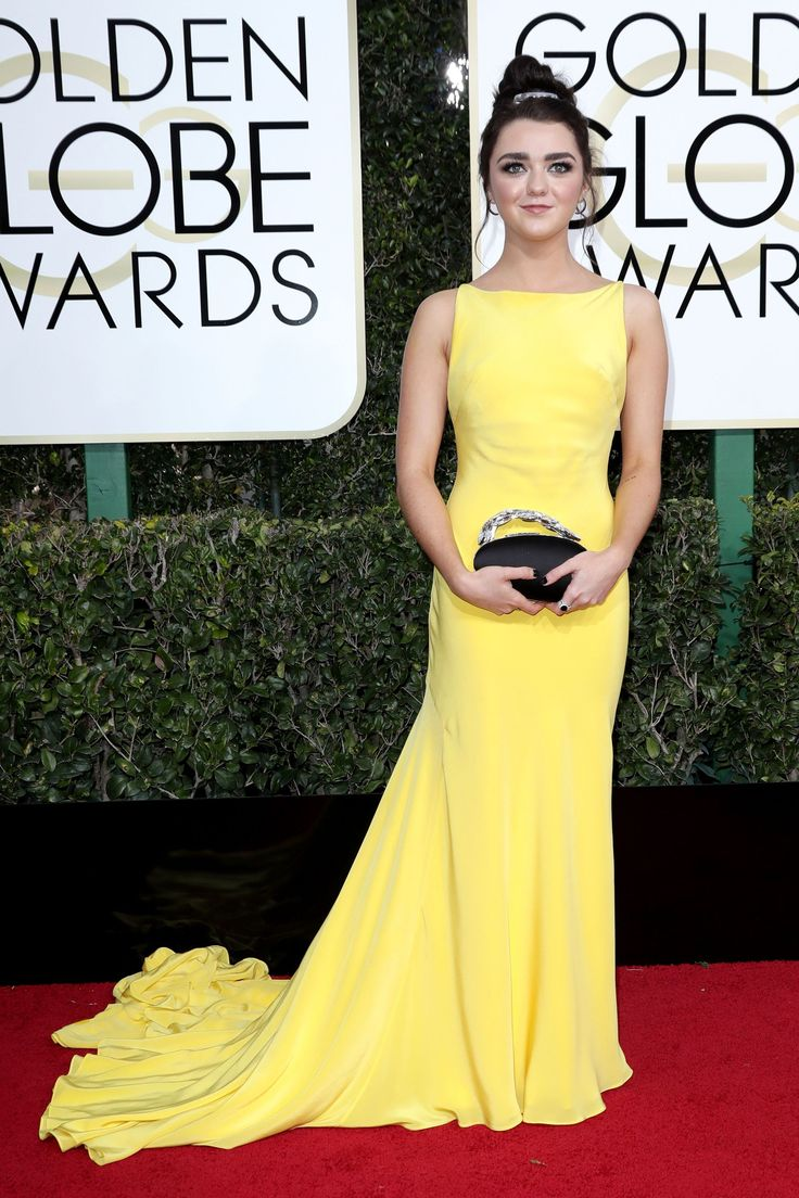2017 Golden Globes: Is Maisie Williams proof that the theory about how Kate Middleton holds her clutch is actually true? Royal Family etiquette stuff aside, this yellow gown on the Game of Thrones star is so regal, and so good.