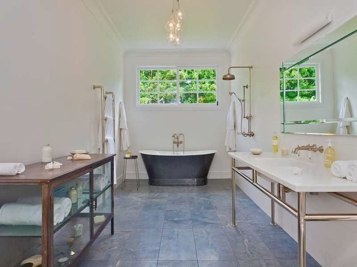 Iron bath, natural light, slate floor, absolutely stunning! #bathroom #holidayrentals #stylishbathroom