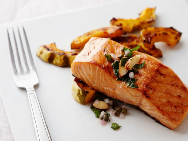 Oven-Baked Salmon : This salmon dinner couldn't be simpler. Season the fish with with salt and pepper, and then pop it in the oven to bake to perfection in 15 minutes. An easy-to-make parsley and almond salsa goes on top.