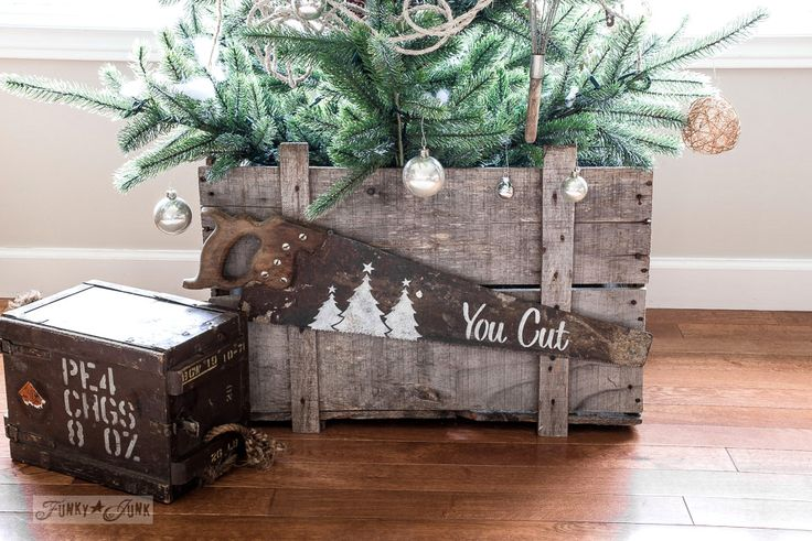 Ikea natural looking faux Christmas tree in an old crate, decorated in metals, with a You Cut saw sign with Funky Junk's Old Sign Stencils | funkyjunkinteriors.net
