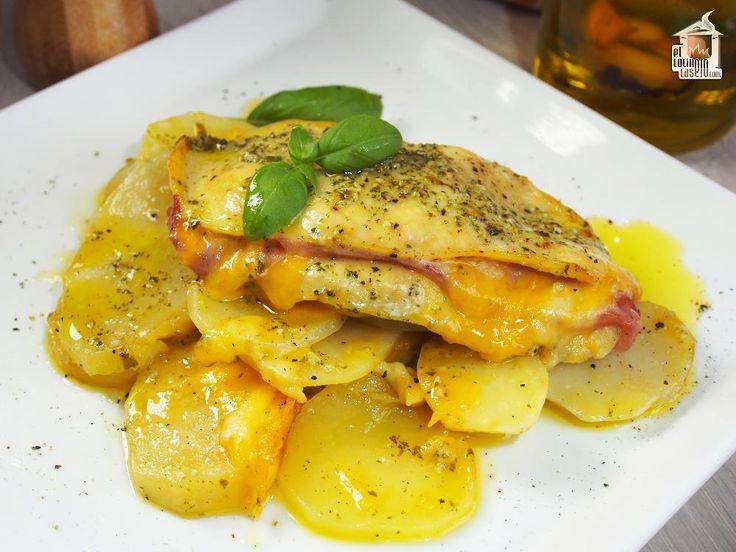 Filetes de pechuga de pollo rellenas de jamón y queso, cocinadas al horno con patatas panadera y aceite de albahaca.