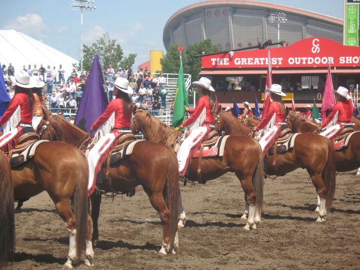 Stampede riders during national anthem at start of daily rodeo at Calgry Stampede. For Stampede info see http://Calgary.FoundLocally.com/entertainment/fest-stampede.htm