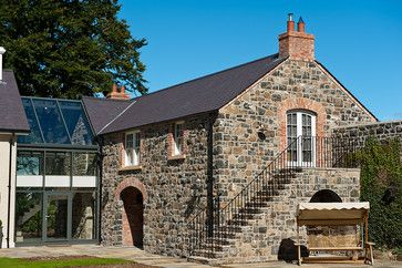 Restored Country Home Broken Up By a Series of Linked Volume - rustic - Exterior