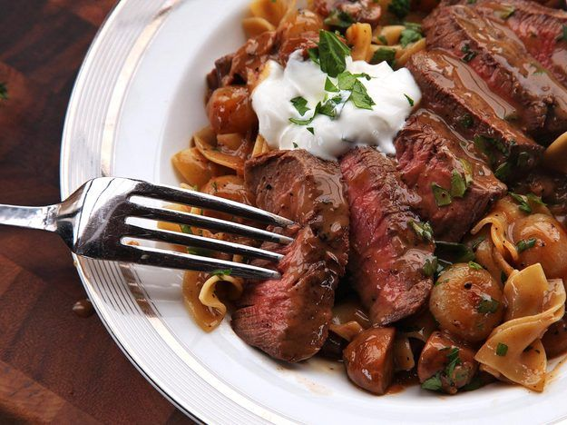 Beef stroganoff is a dish of quick-cooked beef in a creamy sauce made flavored with mushrooms, onions, paprika, and sour cream. In our upgraded version, the beef is cooked as a whole steak to maintain a more tender, medium-rare center, while the sauce is carefully layered and constructed to optimize its rich, comforting, savory flavor.