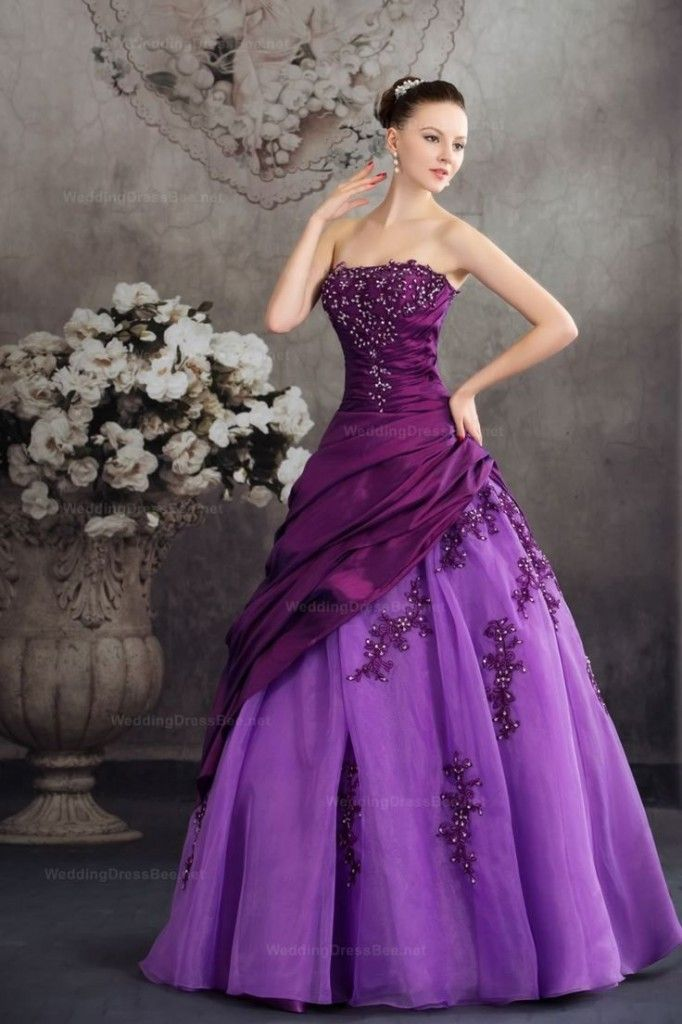 Beautiful strapless, two-tone purple ball gown. The runched strapless bodice and polonaise is in a dark plum color of Duchesse Satin or silk taffeta. The skirt is in a bright mauveine or crystal violet color of chiffon or tulle. I love the flower-beaded overlay on the bodice. Gorgeous! I love the modern dress with the olden day backdrop.