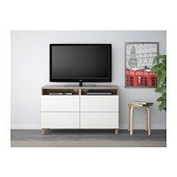IKEA - BESTÅ, Meuble télé avec tiroirs, effet noyer teinté gris/Lappviken blanc, glissière tiroir, ouv par pression, , Les tiroirs sont équipés d'un système intégré d'ouverture par pression, ce qui évite d'avoir à y fixer des poignées ou des boutons.Vous pouvez facilement dissimuler les câbles du téléviseur et tout autre équipement tout en les ayant à portée de main grâce aux ouvertures pratiquées au dos du meuble télé.Le passe-câbles sur la partie supérieure de…