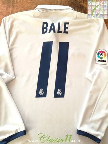 Official Adidas Real Madrid home long sleeve football shirt from 2016/17. Complete with Bale #11 on the back of the shirt and La Liga patch on the sleeve.
