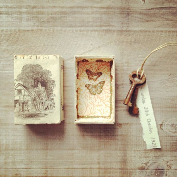 Altered vintage matchbox with an antique key, lace and paper date inside. via Etsy.